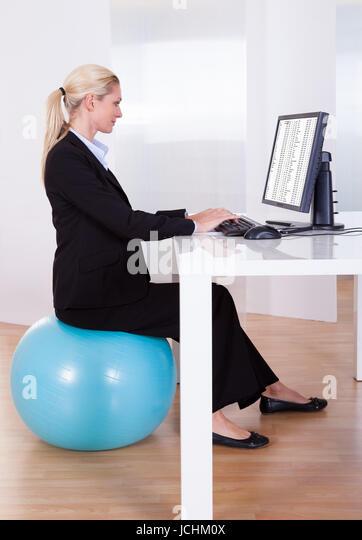 correct sitting posture correct position stock photos correct sitting posture correct position. Black Bedroom Furniture Sets. Home Design Ideas