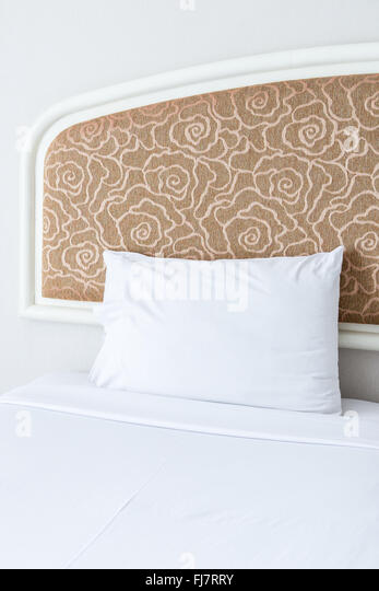 Soft White Pillow On The Large Bed Of The Clean Bedroom.   Stock Image