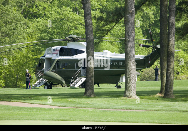 marine one presidential helicopter sitting on golf course in williamsburg va awaiting the arrival of