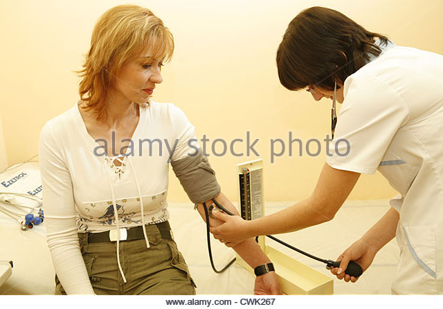 Blood Pressure Woman Stock Photos & Blood Pressure Woman ...