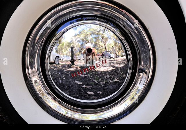 reflection in vintage humber automobile hubcap stock image