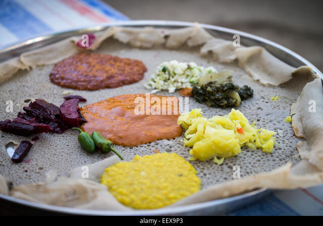 Injera bread stock photos injera bread stock images alamy for Authentic ethiopian cuisine