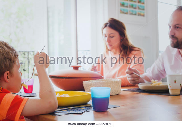 family eating lunch together at home - Stock Image