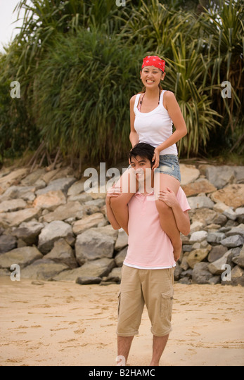 Man Carrying Boyfriend On Shoulders Stock Photos Amp Man