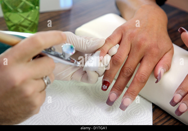 Airbrush and woman stock photos airbrush and woman stock images berlin germany a nail designer decorated nails with airbrush designs stock image solutioingenieria Choice Image