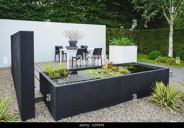 Garden With Modern Garden Furniture And Trendy Pond   Stock Image