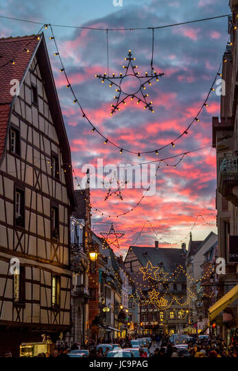 christmas star in front of pink dusk clouds at the christmas market in colmar france - Christmas Market Dc