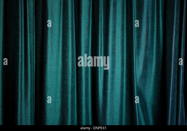 Background Of Dark Green Velvet Curtains Highlighted As They Catch Reflected Light