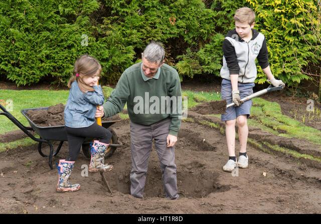 Children digging stock photos children digging stock for Digging a garden pond