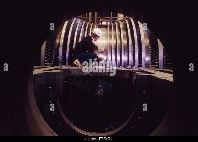 male engineer inspecting the turbine rotors at a nuclear power plant stock image - Power Plant Engineer