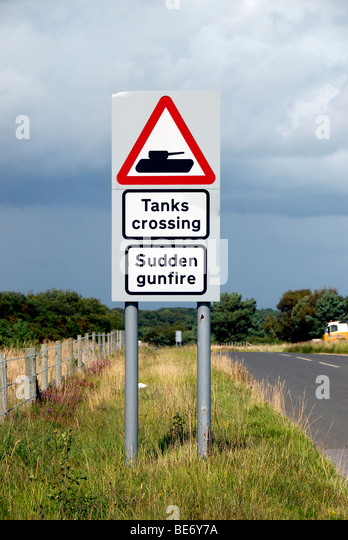 http://l7.alamy.com/zooms/8dca3dc18c1e414f94181f07906a391c/tanks-crossing-and-sudden-gunfire-road-warning-sign-at-army-firing-be6y7a.jpg