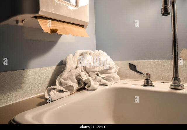 Old Clean Public Hospital Bathroom With Towel And Paper Towel Dispenser    Stock Image