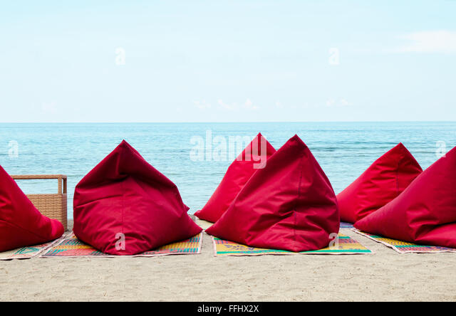 Red Bean Bags On The Sand Beach In Bali Indonesia Stock Image