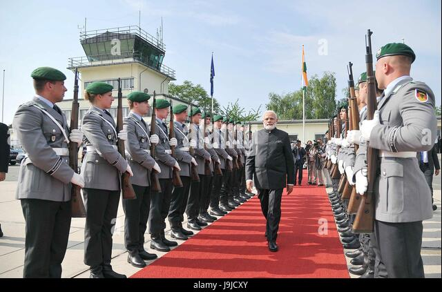 Indian Prime Minister Narendra Modi walks past the German honor guard as he prepares to depart for Spain after a - Stock Image