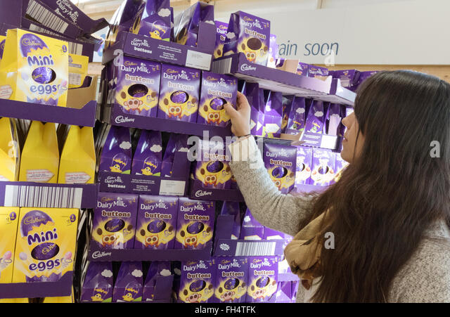 Easter eggs supermarket stock photos easter eggs supermarket a woman buying easter eggs in a tesco supermarket store suffolk uk stock image negle Image collections