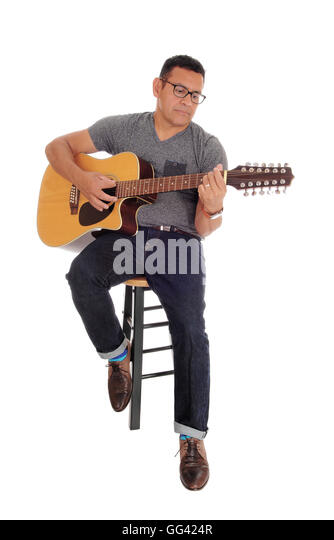 A Hispanic handsome man sitting on a chair and playing his guitar isolated for white  sc 1 st  Alamy & Playing Guitar Sitting On Stool Stock Photos u0026 Playing Guitar ... islam-shia.org
