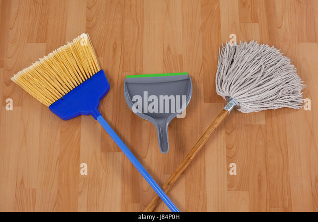 dustpan sweeping broom and mop on wooden floor stock image