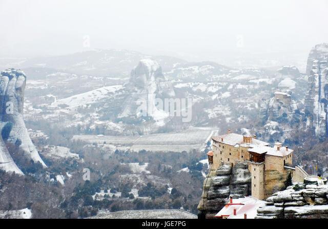 The Holy Monastery of Rousanou under heavy snow , Meteora, Kalabaka, Greece - Stock Image
