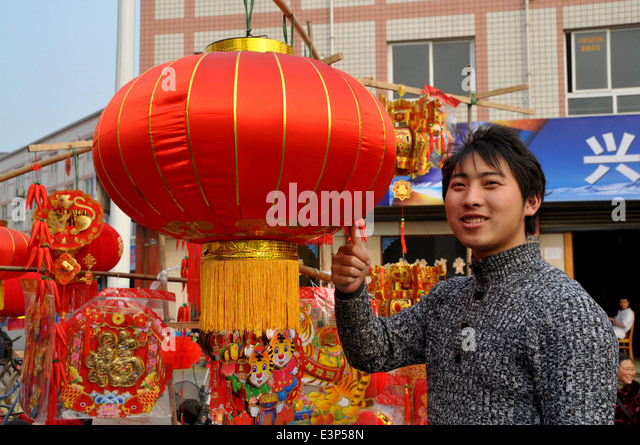pengzhou china vendor selling chinese new year decorations in long xing square stock - How Long Is The Chinese New Year