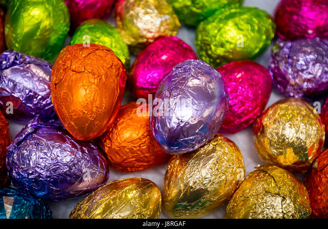Vibrant Hand Wrapped Chocolate Easter Eggs In Bright Colours Of Foil