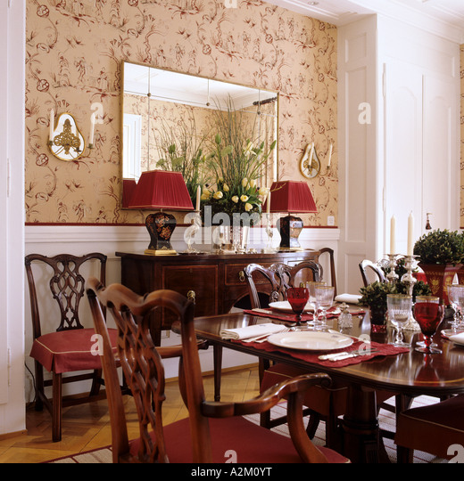 Delightful Dining Room With Chippendale Chairs And Patterned Wallpaper   Stock Image