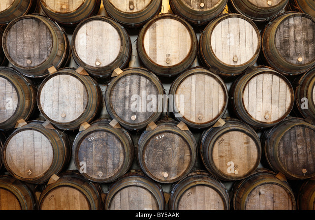 stacked oak barrels maturing red wine. stacked oak barrels in a winery stock image maturing red wine m
