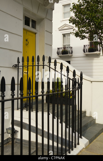 Yellow Door And Railings Of A House In Kensington Chelsea London UK   Stock  Image