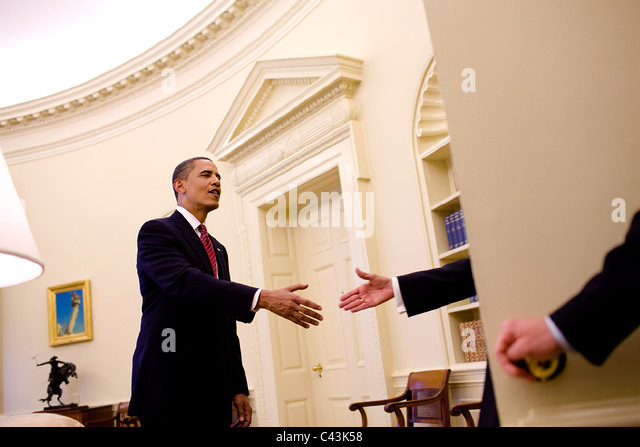 president barack obama shakes hands with a guest entering the oval office may 20 barack obama enters oval