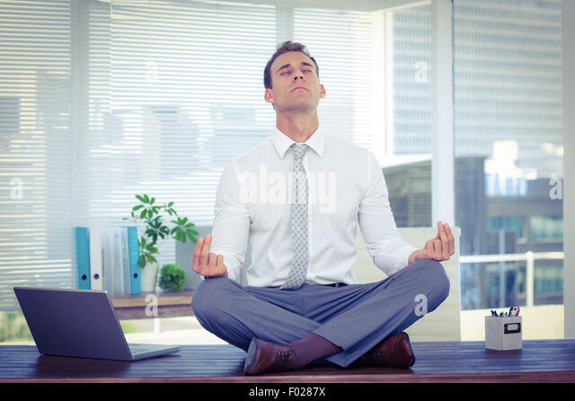 meditation businessman office. perfect businessman zen businessman doing yoga meditation  stock image for meditation businessman office a