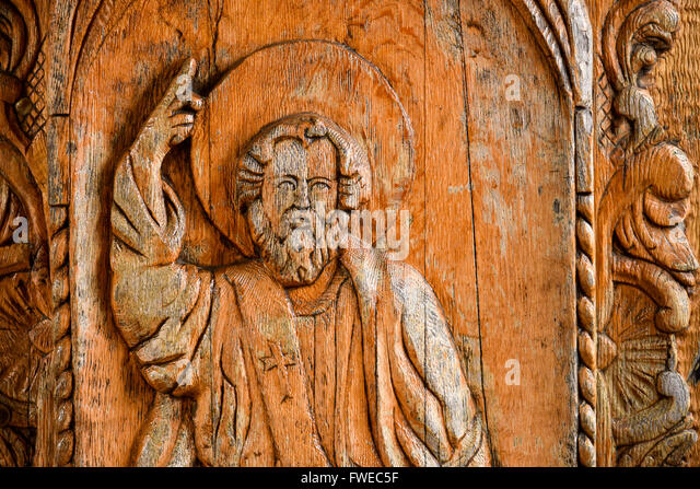 God Sculpture In Wood On A Christian Door Church   Stock Image