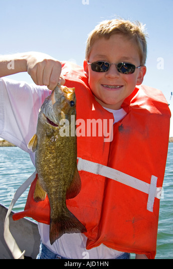 Bass fishing stock photos bass fishing stock images alamy for Bass fishing life jacket