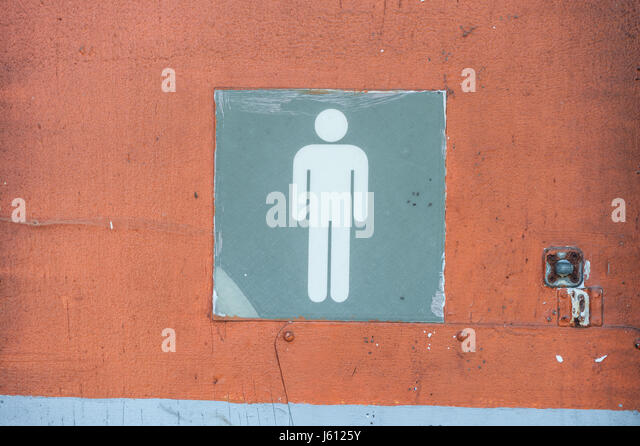mens bathroom sign in an old abandoned gas station with cracked paint stock image - Mens Bathroom Sign