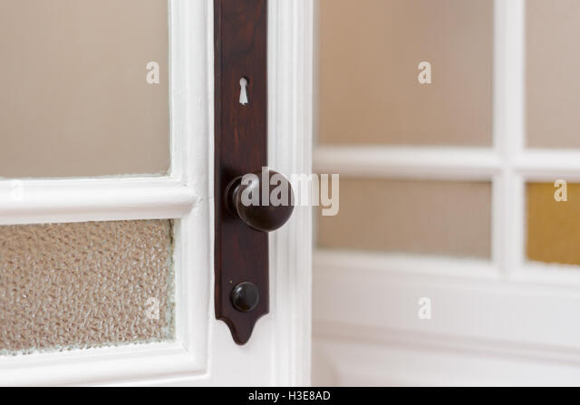 Antique door handle with stained glass frames - Stock Image - Antique Door Handle Stock Photos & Antique Door Handle Stock