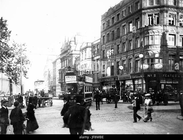 Trams and pedestrians on Nassau Street, viewed from Grafton Street 34452143730 o - Stock Image