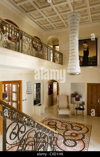 Entrance hall chandelier stock photos entrance hall for Spanish villa interior design