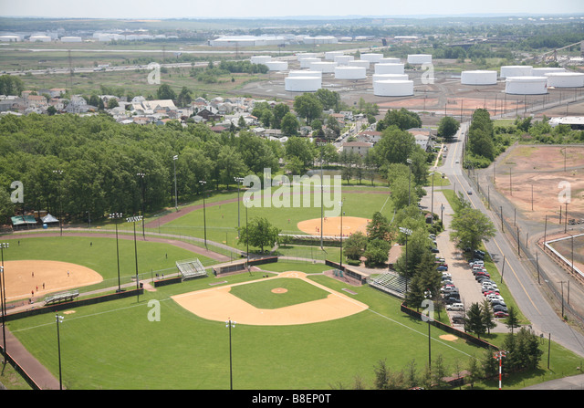 Aerial View Of Baseball Fields Near Oil Storage Tanks In LInden New Jersey,  U.S.A.
