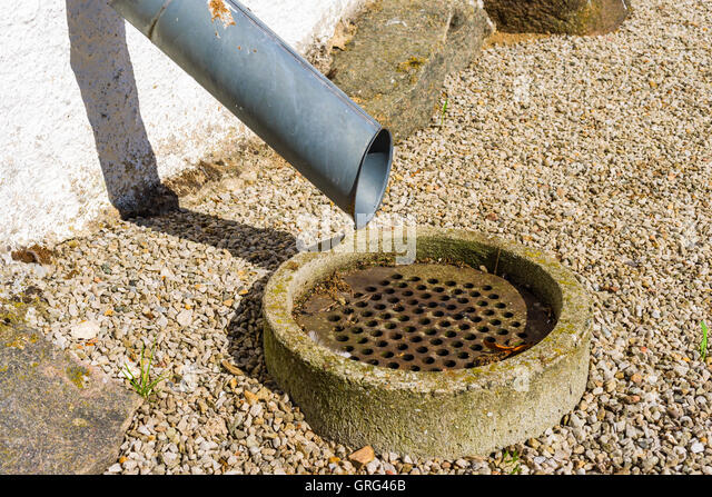 Drain pipe gravel stock photos drain pipe gravel stock for Outdoor drain pipe