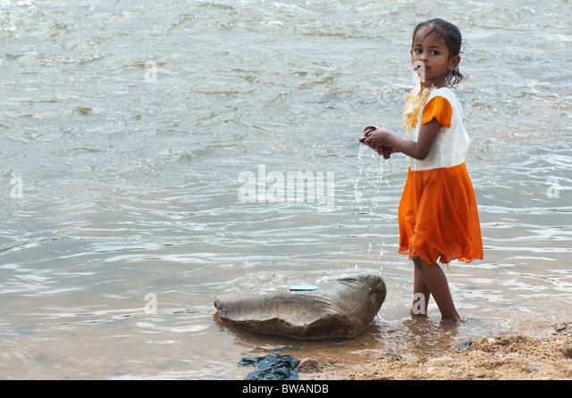Girl Washing Clothes In River Stock Photos & Girl Washing ...