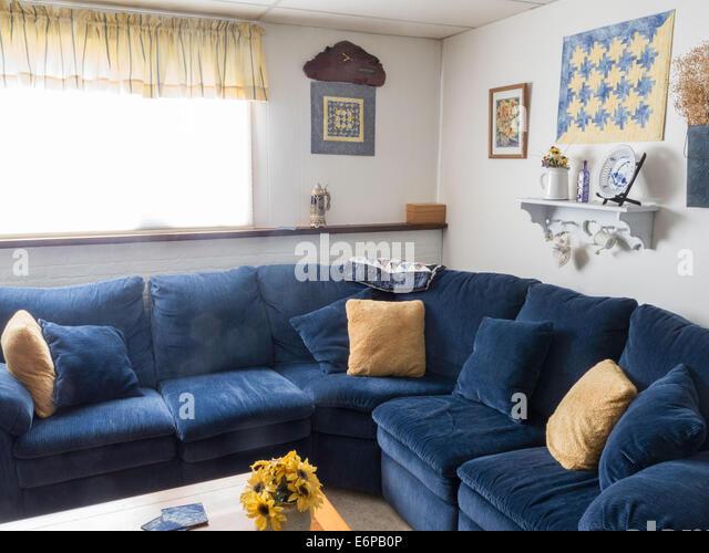 Yellow sofas cushions stock photos yellow sofas cushions for Comfortable family sofa