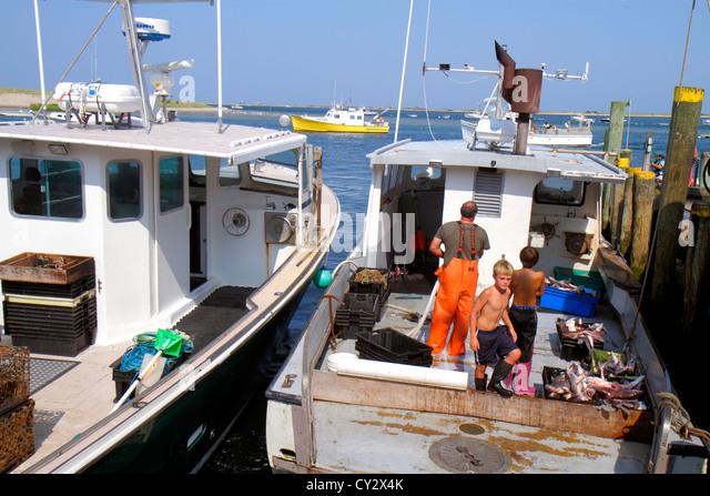 Taking kids fishing stock photos taking kids fishing for Mass commercial fishing