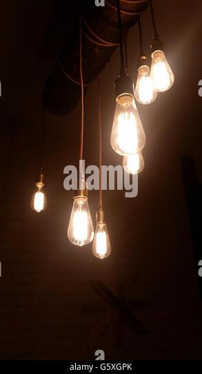 decorative light bulbs in a dark room stock image - Decorative Light Bulbs