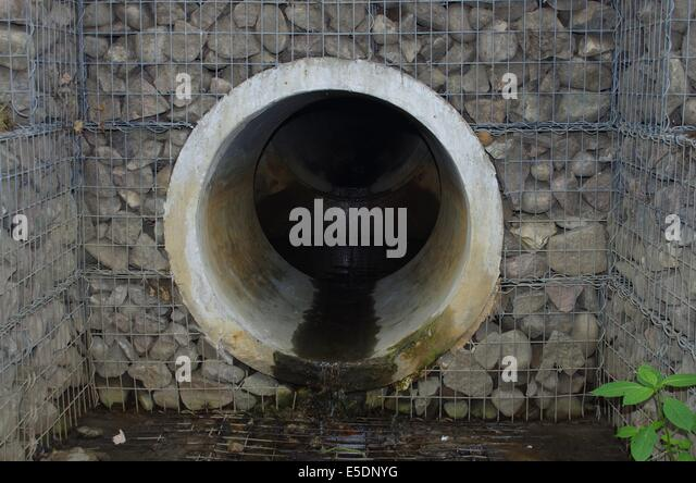 Sewage pipe stock photos sewage pipe stock images alamy sewage pipe and stones stock image sciox Images