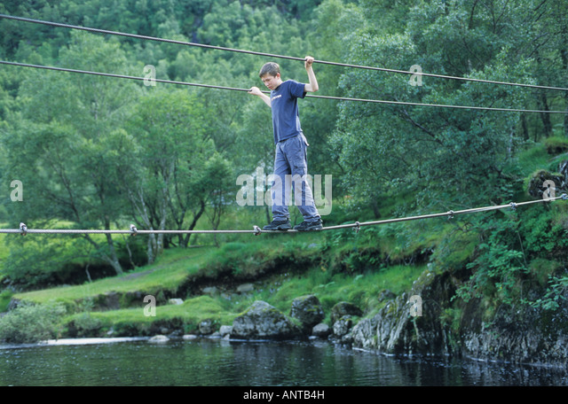 Boy On Wire Rope Bridge Stock Photos & Boy On Wire Rope Bridge ...