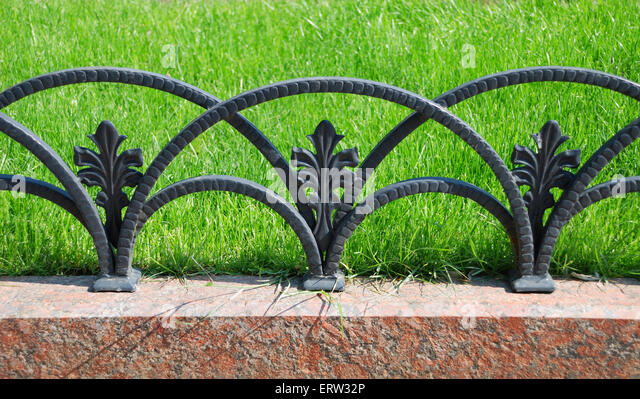 decorative fencing near sidewalk in park and one yellow flower stock image - Decorative Fencing