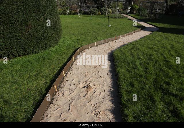 Laying New Garden Path   Lawn Edging Strip Surrey England   Stock Image