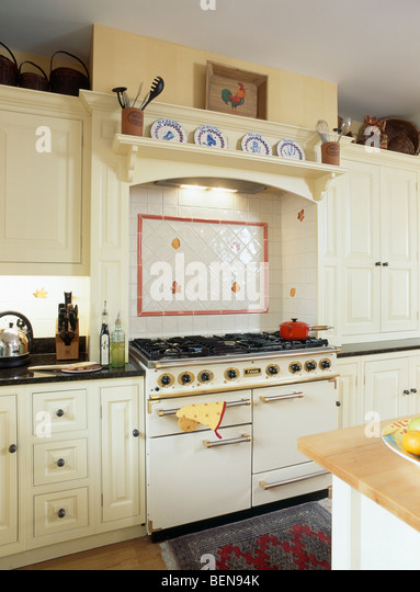 Tiling kitchen red stock photos tiling kitchen red stock for Traditional kitchen wall tiles