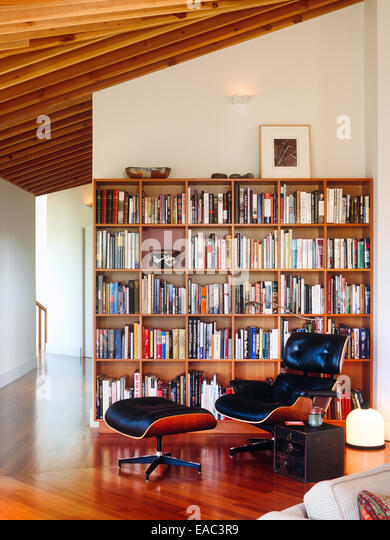 Contemporary Living Room With Book Shelves And Eames Lounge Chair Ottoman By Herman Miller