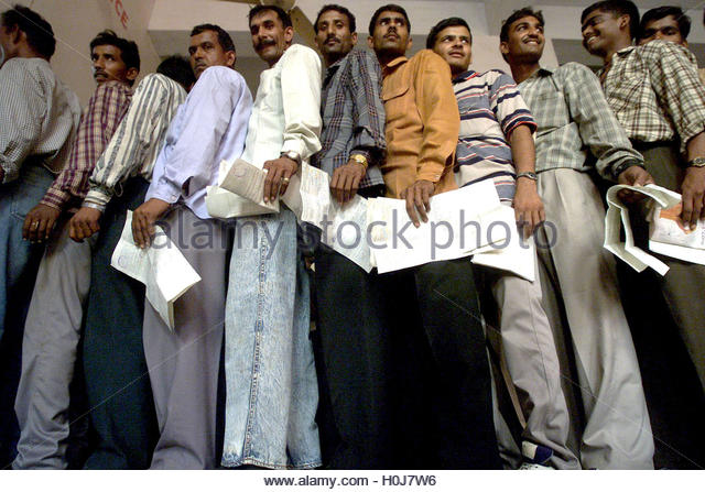 indian soldiers stand in a queue with train reservation forms in their
