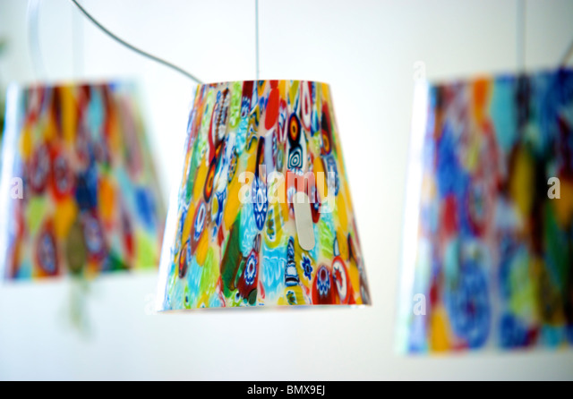 Multi coloured glass lamp shades - Stock Image