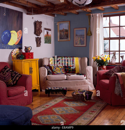 Patterned Rug In Blue And White Cottage Living Room With Colourful Throws  And Cushions On The